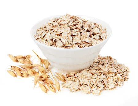 Rolled oats in a plate isolated on white background Archivio Fotografico