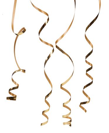 Goud serpentijn op een witte achtergrond Stockfoto