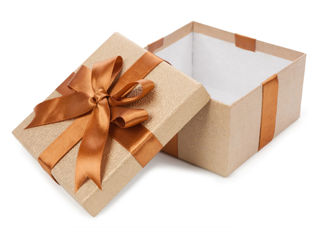 Gift box with gifts and brown bow isolated on white background. Фото со стока