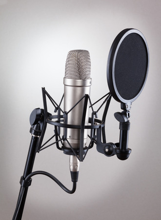 Studio microphone on a gray background.