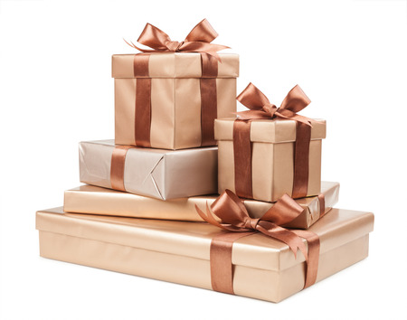 boxes with gifts and brown bows isolated on white background Фото со стока