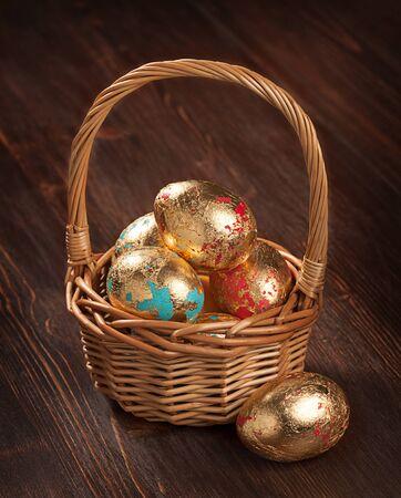 Golden eggs in a basket