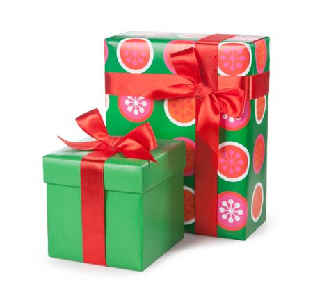 Green boxes with gifts tied with red ribbon and bows isolated on white background.