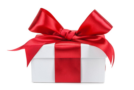 White gift box with red ribbon and bow isolated. Stockfoto