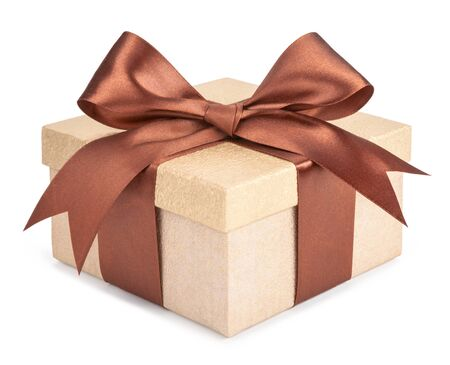Gold box with gifts and brown bow isolated om white background Foto de archivo