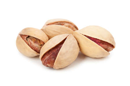 Pile of pistachios isolated on white background.