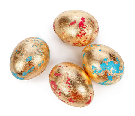 Hand made gold eggs on white background.