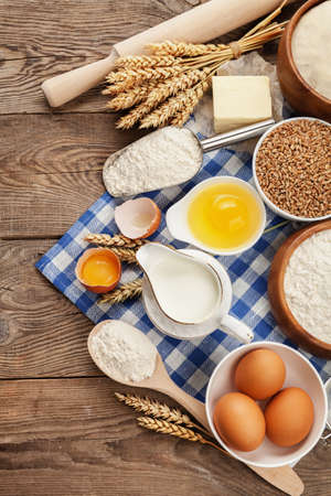 Products for cooking, still life with flour, milk, egg and wheat.