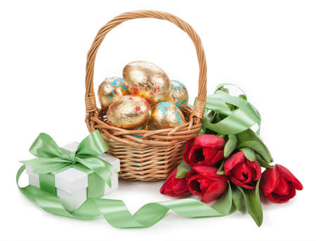 Basket with easter golden eggs on white background