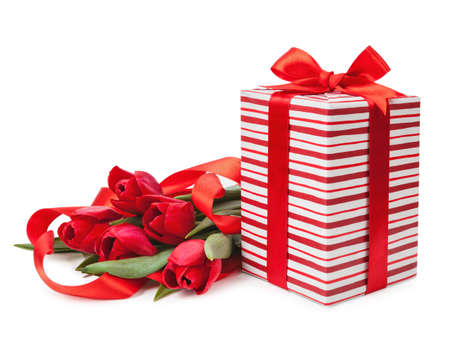 boxes with red ribbons and a bouquet of tulips isolated. Фото со стока