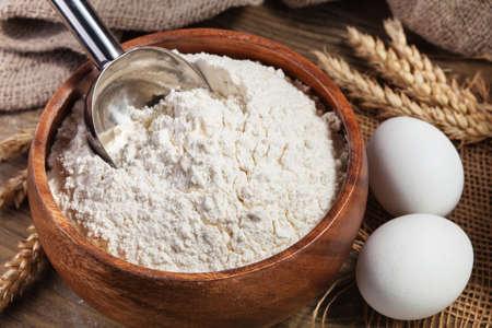 Flour and eggs on a kitchen table. Фото со стока