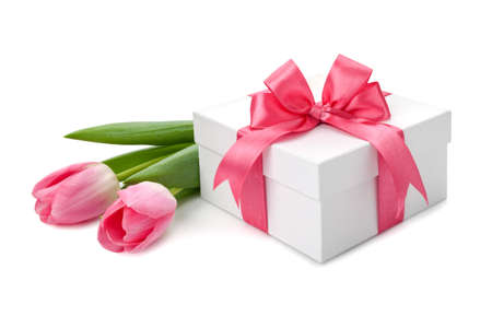 Fresh Tulips and boxes with gifts isolated on white background. Фото со стока