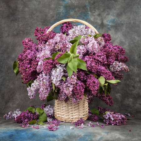 bouquet of lilac in a basket on table