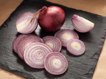 Cut red onion on a chopping board.
