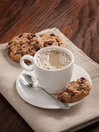 Coffee cup and biscuits on the table.