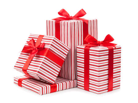 Striped boxes with gifts tied bows on white background.