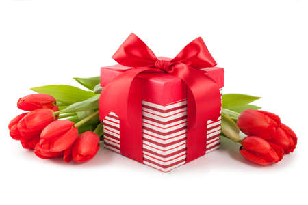 Giftbox and tulips isolated on white background