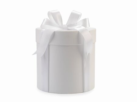 Round white box with bow isolated on background Фото со стока