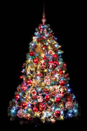 Beautiful Christmas tree on a black background. new year concept Фото со стока