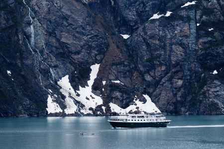With a majestic background, this is a small tourist excursion out to view Glacier Bay