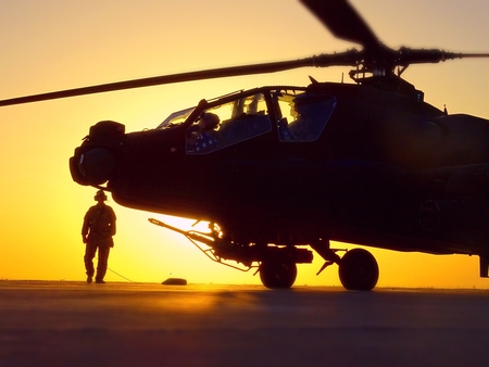 Crew chief readies an attack helicopter for a combat mission flight over Iraq. Stock Photo - 96453629