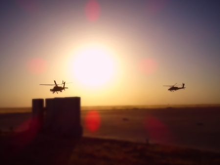 Pair of attack helicopters take off for a combat mission in Iraq