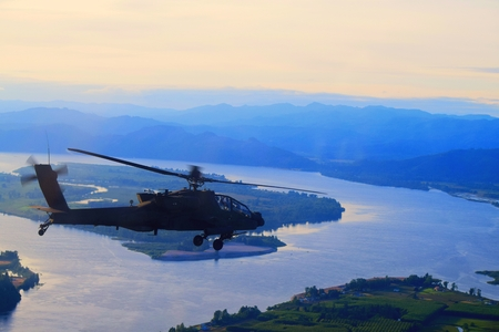 Attack helicopter flying over the west coast of Oregon. Stock Photo