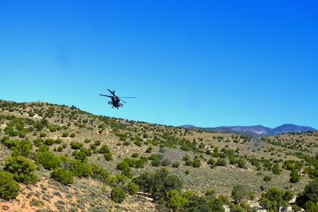 AH-64 Apache Attack Helicopter Conducts Low Level Flight over the Desert