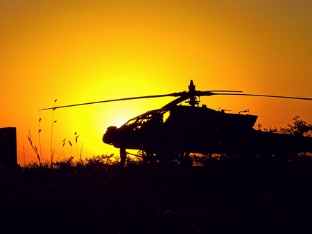 Helicopter Rests in the Iraq Sunset