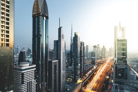 Long exposure view of traffic and skyline from rooftop at sunset Dubai - UAE Foto de archivo