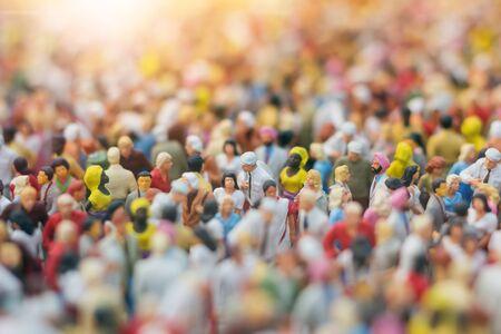 Colorful miniature crowd in the Sun. Multiracial gathering of people. Archivio Fotografico