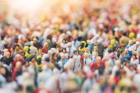 Colorful miniature crowd in the Sun. Multiracial gathering of people. Standard-Bild