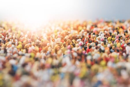 Colorful miniature crowd in the Sun. Multiracial gathering of people.