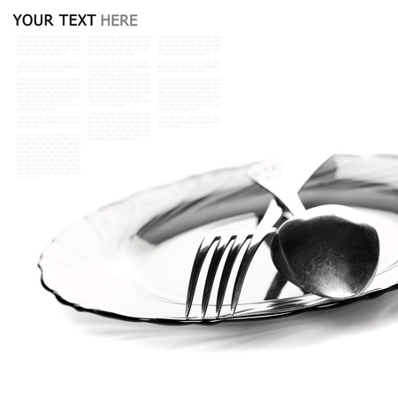 Close up of a silver spoon and fork on a white background (with sample text) photo