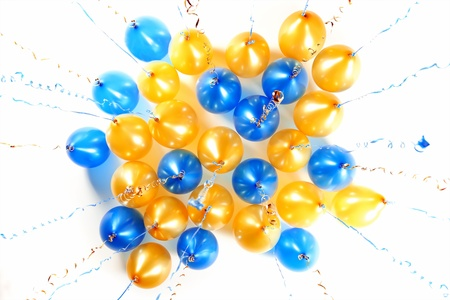 colourful balloons with golden and blue streamers isolated on white photo
