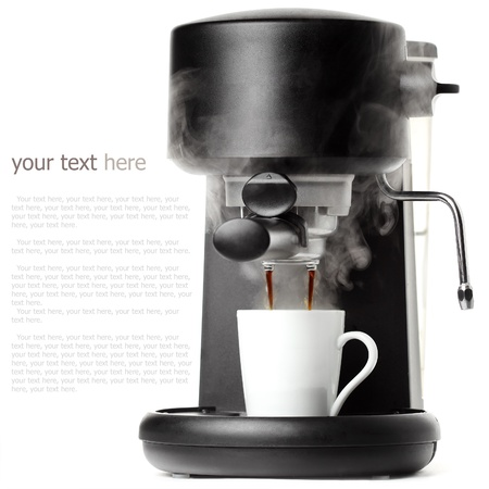 Stylish black coffee machine with a white cup Foto de archivo