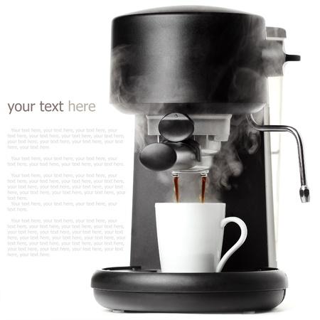 Stylish black coffee machine with a white cup Reklamní fotografie