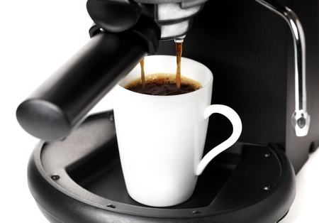 Coffee maker pouring hot coffee photo