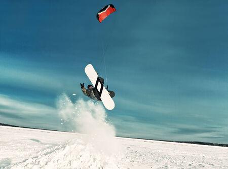 kite in the blue sky, winter riding a kite