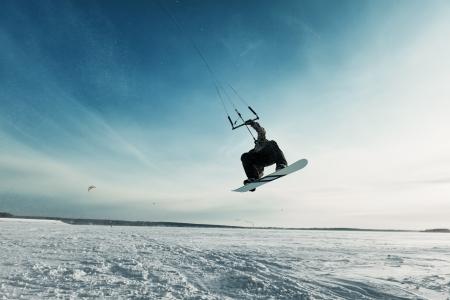 kite surf: kite in the blue sky, winter riding a kite