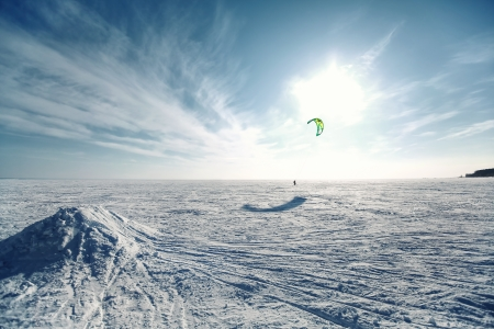 kiting: kiting on a snowboard on a frozen lake Stock Photo