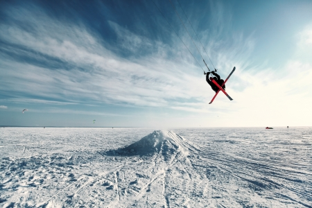 kite surf: kiting on a snowboard on a frozen lake Stock Photo