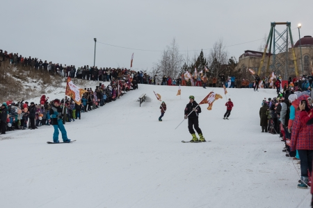 olympic symbol: Novosibirsk, Russia - December 7, Adults and children awaiting the Olympic torch relay in Novosibirsk