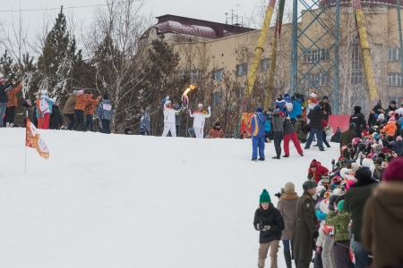 novosibirsk: Novosibirsk, Russia - December 7, Adults and children awaiting the Olympic torch relay in Novosibirsk