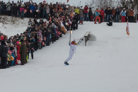 olympic symbol: Passing the torch relay, in Novosibirsk, Russia
