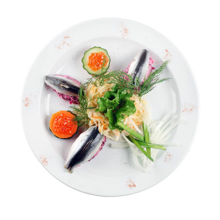 Herring salad on a plate (white background) photo