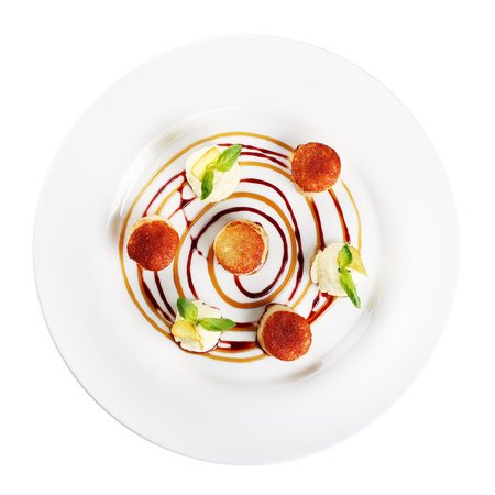 coquille: fried scallops on a plate (white background) Stock Photo