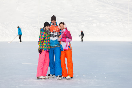 iceskating: Young people, friends, ice-skating winter and recreation on the frozen lake Stock Photo