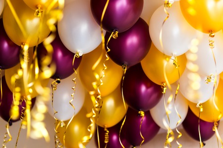 lacet: colourful balloons, golden, white, red streamers isolated on white