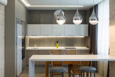 Modern kitchen interior in new luxury home, apartment, bright